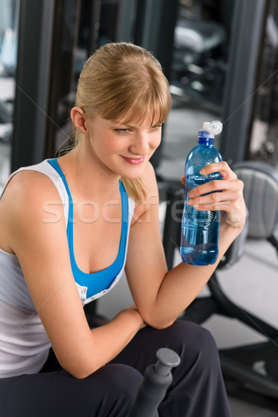 Health club young woman relax at machine Stock photo © CandyboxPhoto
