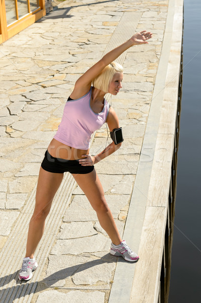 Fit woman stretch body by water pier Stock photo © CandyboxPhoto