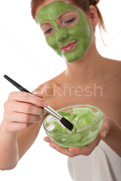 Body care series - Young woman applying facial mask Stock photo © CandyboxPhoto