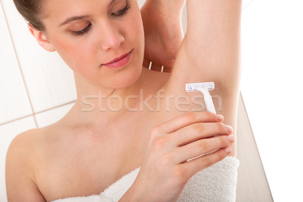 Body care series - Beautiful woman shaving her armpit Stock photo © CandyboxPhoto