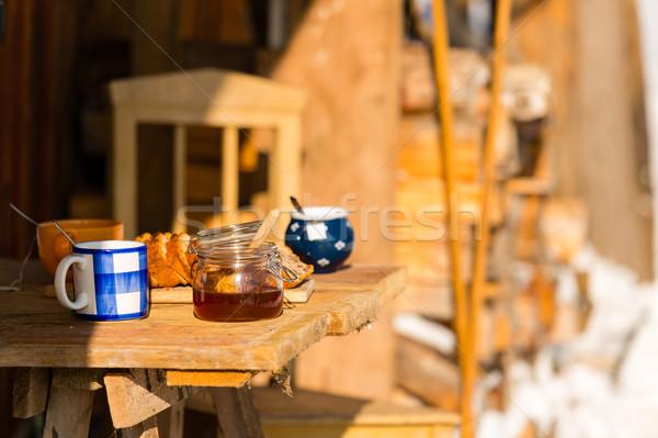 Kış sabah kahvaltı dışında ahşap kulübe Stok fotoğraf © CandyboxPhoto