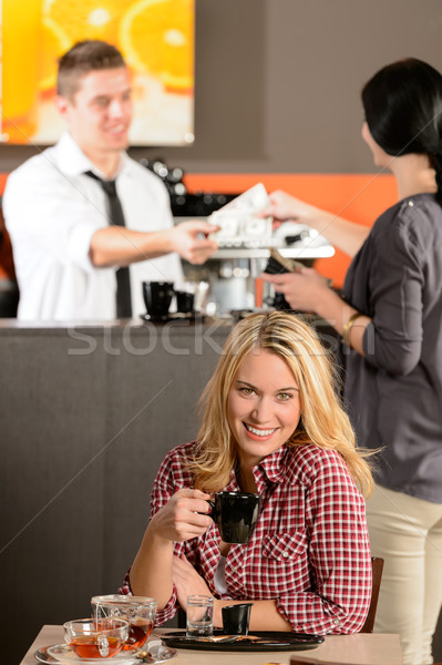 Happy female customer drinking espresso in cafe Stock photo © CandyboxPhoto