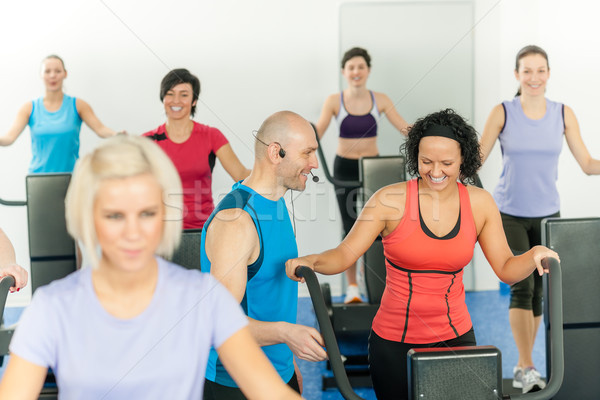 Fitness instructor leading class of alpinning Stock photo © CandyboxPhoto