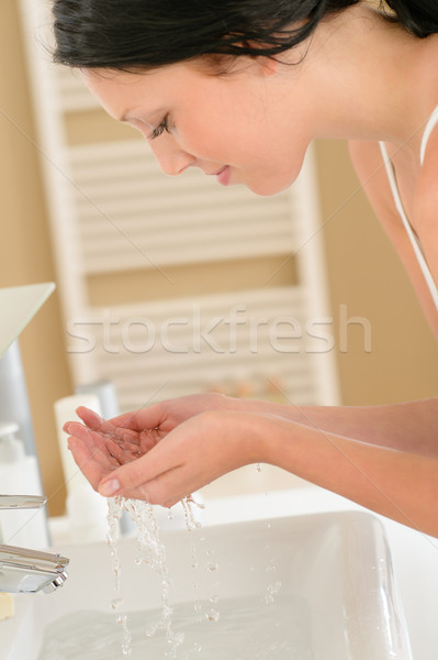 Woman wash face at basin bathroom Stock photo © CandyboxPhoto