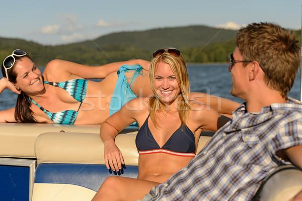 Tomar el sol amigos verano yate jóvenes hablar Foto stock © CandyboxPhoto