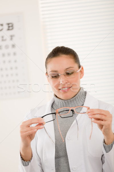 Optician doctor woman with glasses and eye chart Stock photo © CandyboxPhoto