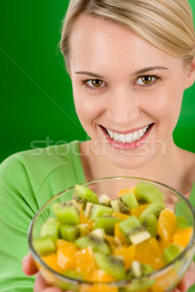 Femme salade de fruits bol vert Photo stock © CandyboxPhoto