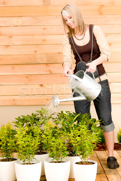 Gardening woman watering plant spring terrace Stock photo © CandyboxPhoto