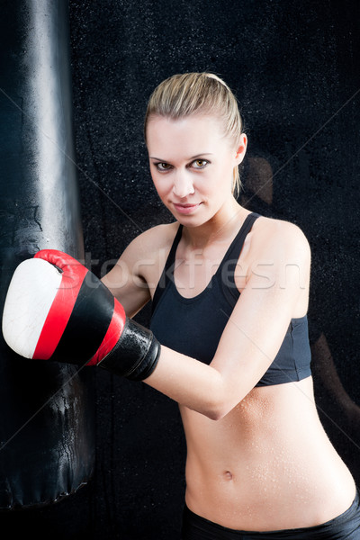 Boxing training woman in black hold punching bag Stock photo © CandyboxPhoto