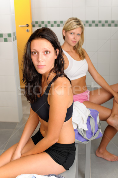 Stock photo: Locker room two sportive women sitting fitness
