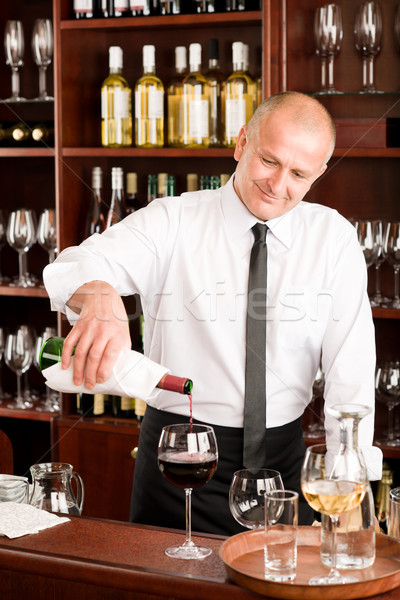 Wine bar waiter pour glass in restaurant Stock photo © CandyboxPhoto