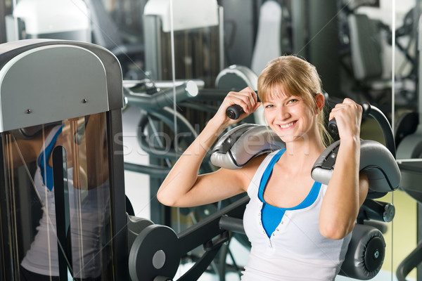 Fitness center young woman exercise abdominal Stock photo © CandyboxPhoto
