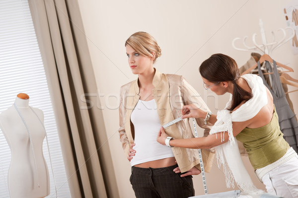 Fashion model fitting clothes by professional designer Stock photo © CandyboxPhoto