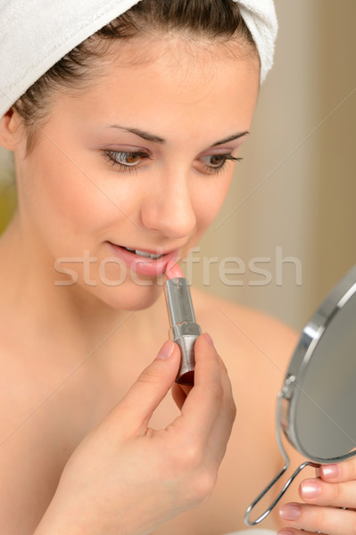 Young teenager girl using lipstick handheld mirror Stock photo © CandyboxPhoto