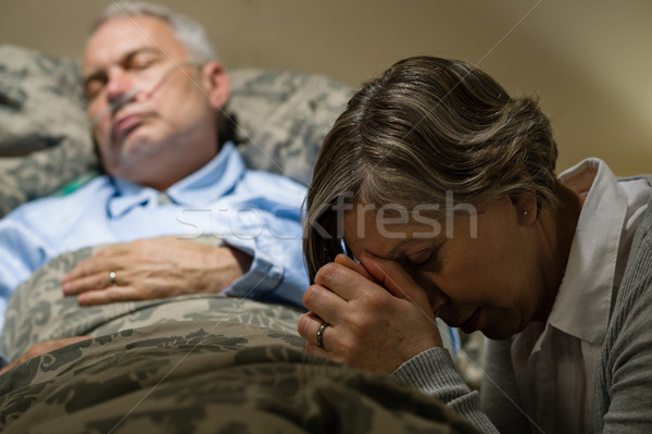 Uneasy senior woman praying for sick man Stock photo © CandyboxPhoto