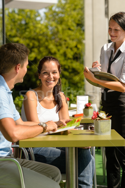 Couple at cafe ordering from menu waitress Stock photo © CandyboxPhoto