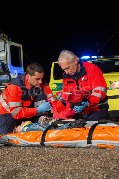 Paramedic team giving firstaid to injured woman Stock photo © CandyboxPhoto
