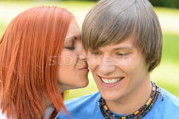 Amoroso mulher jovem beijando bochecha Foto stock © CandyboxPhoto