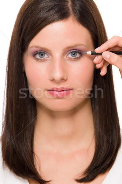 Stock photo: Facial portrait woman apply eye pencil lines