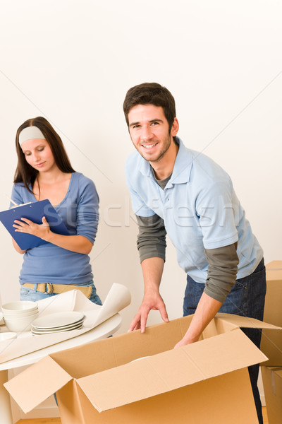 Moving home young happy couple unpacking boxes  Stock photo © CandyboxPhoto