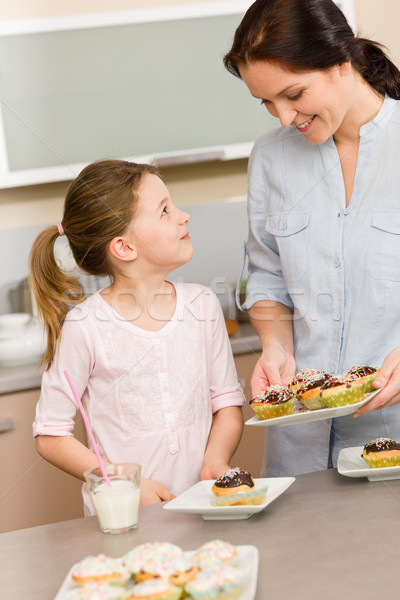 Little girl taste baked cupcakes with mum Stock photo © CandyboxPhoto