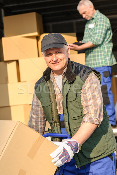 Delivery service mover man cardboard box Stock photo © CandyboxPhoto