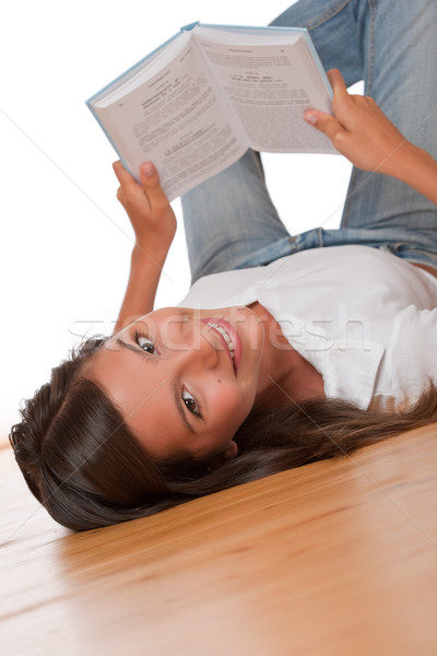 Brown hair teenager lying down on wooden floor  Stock photo © CandyboxPhoto