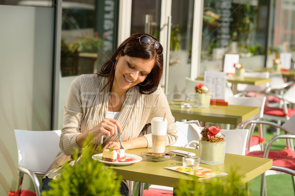 Woman at cafe eating cheesecake dessert happy Stock photo © CandyboxPhoto