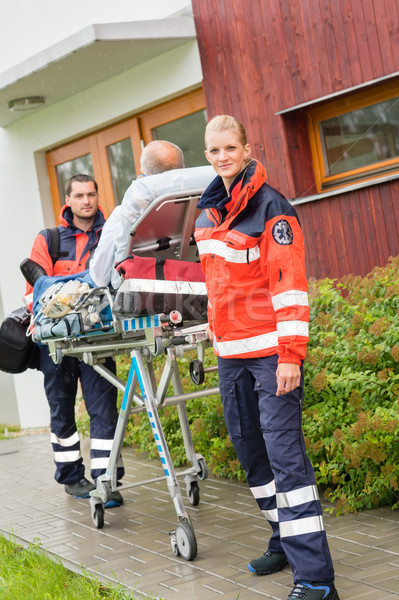 Paramedics with patient on stretcher ambulance aid Stock photo © CandyboxPhoto