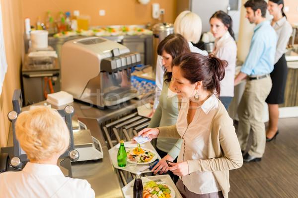 Cafetaria vrouw salaris Bill kassier houden Stockfoto © CandyboxPhoto
