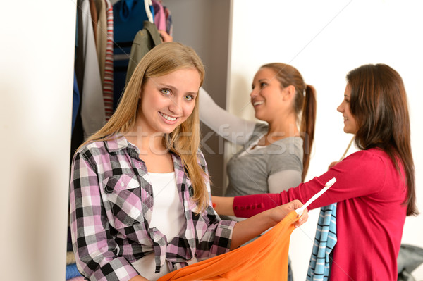 Happy teenagers choosing clothes from wardrobe Stock photo © CandyboxPhoto