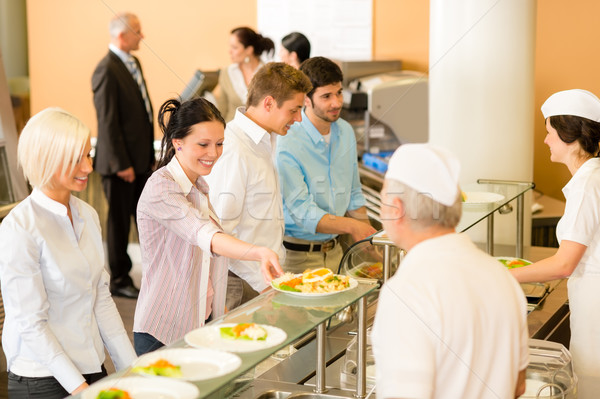Office woman in canteen cook serve meals Stock photo © CandyboxPhoto