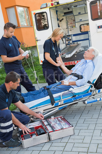 Paramedic team assisting injured man on stretcher Stock photo © CandyboxPhoto