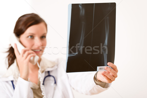 Stock photo: Female doctor with x-ray and phone