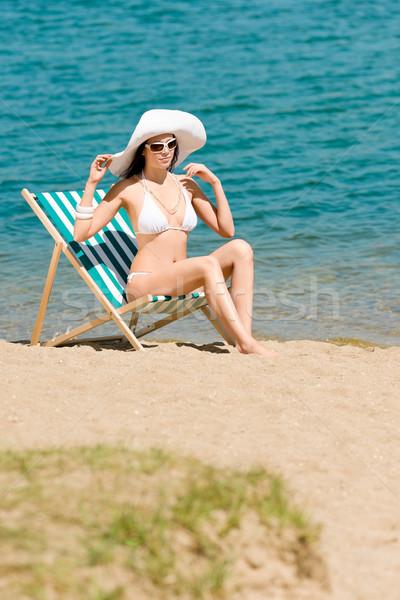 Summer slim woman sunbathing in bikini deckchair Stock photo © CandyboxPhoto