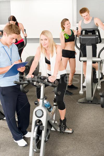 Stock fotó: Fitnessz · fiatal · lányok · tornaterem · oktató · bicikli