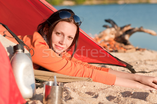 Camping happy woman in tent by campfire Stock photo © CandyboxPhoto