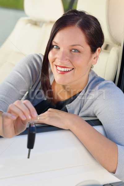 Stock photo: Attractive businesswoman in new car showing keys