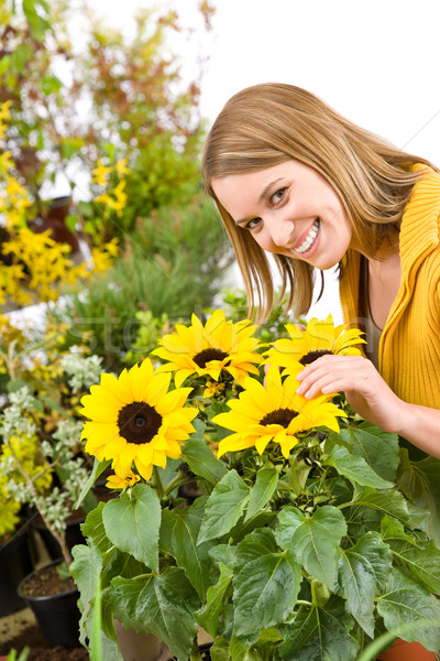 Stock photo: Gardening - portrait of woman with sunflowers