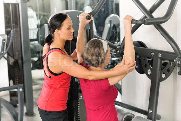 Senior woman at fitness center exercise shoulder Stock photo © CandyboxPhoto