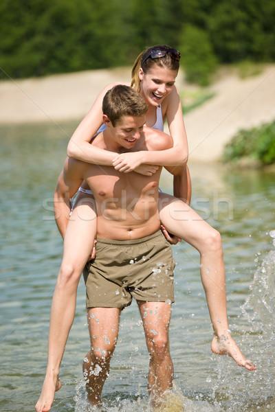ピギーバック 幸せ カップル 楽しむ 太陽 湖 ストックフォト © CandyboxPhoto