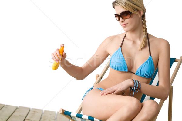 Plaży młoda kobieta bikini opalenizna mleczko kosmetyczne okulary Zdjęcia stock © CandyboxPhoto