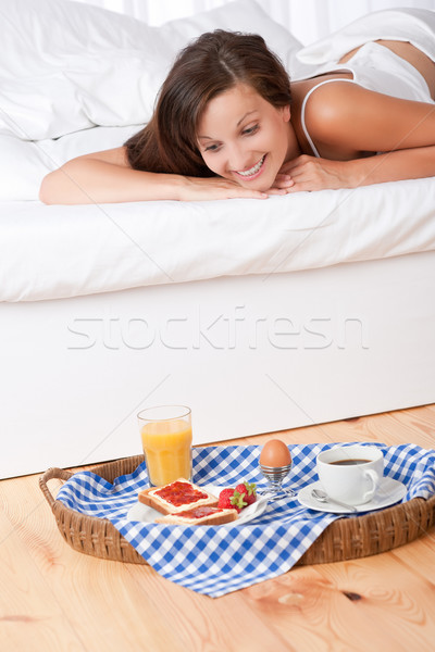 Smiling woman in bed watching homemade breakfast Stock photo © CandyboxPhoto