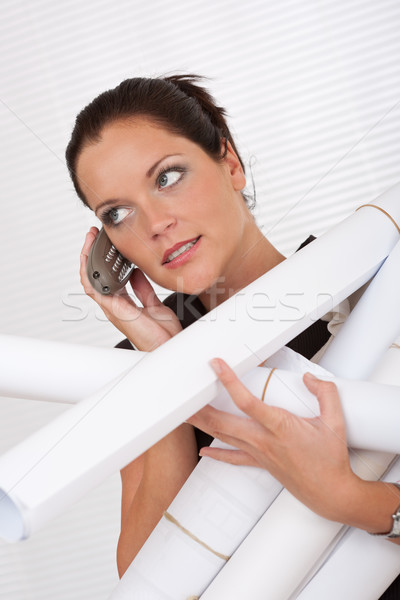 Young attractive female architect holding plans and telephone  Stock photo © CandyboxPhoto