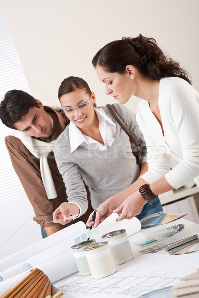 Stock photo: Female interior designer with two clients at office