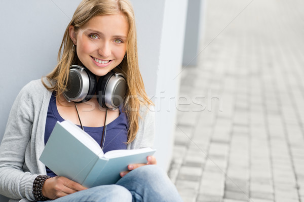 Woman reading book outside of school young  Stock photo © CandyboxPhoto