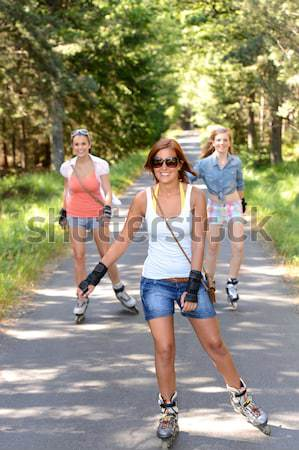 Young woman roller skating outdoors with friends Stock photo © CandyboxPhoto