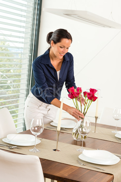 Young woman placing flowers dinner table Stock photo © CandyboxPhoto