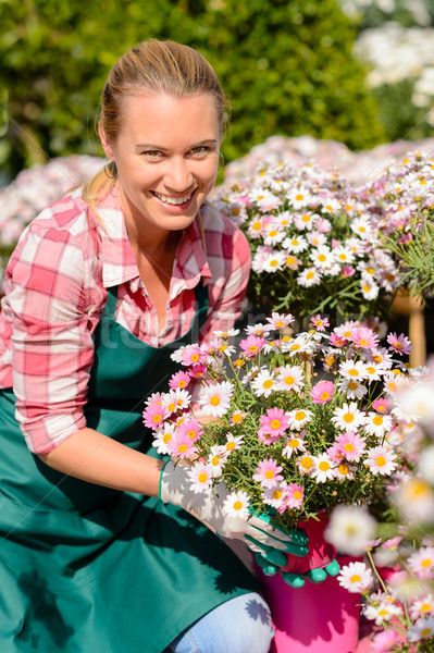 Garden center woman holding potted flowers smiling Stock photo © CandyboxPhoto
