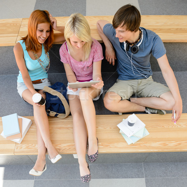 Three college students looking tablet top view Stock photo © CandyboxPhoto